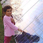 childwithphotovoltaiccollector.jpg